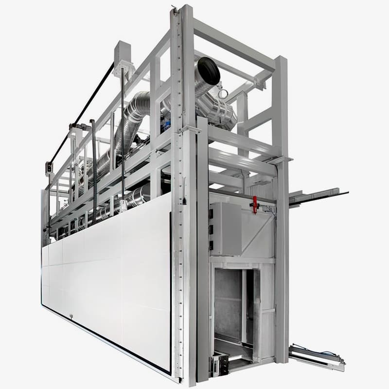 This Fornax curing oven has vertical lift doors on both sides. Objects rotate during curing. Composites: Carbon fiber, glass fiber and epoxy resin. Blades for wind turbines.