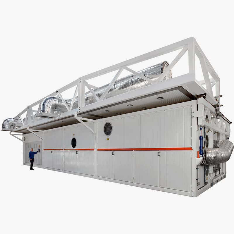 This Fornax curing oven has a sliding top. Objects rotate during curing. Composites: Carbon fiber, glass fiber and epoxy resin. Blades for wind turbines.